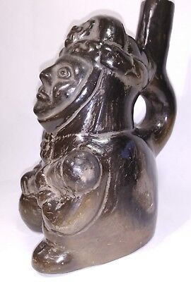 Peru precolombian Moche Sitting warrior Pottery Vessel with Stirrup Spout Handle