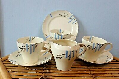 3 Art Deco trios and milk jug, blue lines and silver leaves hand painted