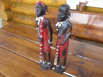 A pair of carved African figures made of wood. Ethnographic antique.