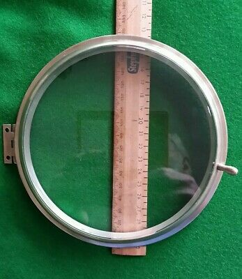 "Ships Clock Parts Brass Bezel 6 5/8"" Dia, c/w Bevelled Glass, Handle & Hinge"