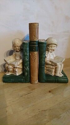 A Charming Pair Of Antique / Vintage Ceramic Old People Sat On Books Bookends