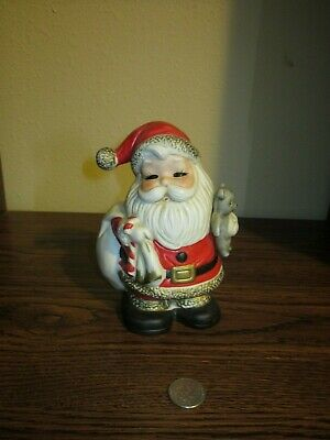 Decorative Santa Claus figurine piggy bank carrying presents & teddy bear design