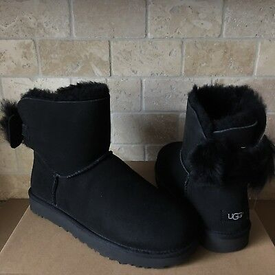 d5ba8a3a0fc UGG MINI FLUFF Bow Black Suede Sheepskin Boots Booties Size Us 9 ...