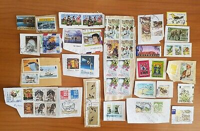 3 scans of world stamps from charity Kiloware on paper