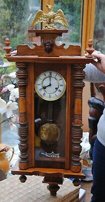 German Wall Clock Oak Wood, Strikes By The Half & The Hour.gold Eagle Top.