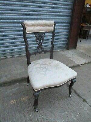 A Victorian Mahogany Nursing Low Chair Carved Back Serpentine Upholstered