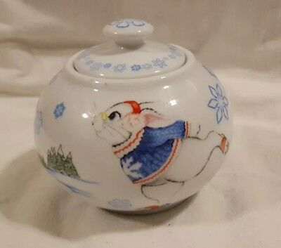 Alice In Wonderland Cafe Sugar Bowl with White Rabbit skiing by Paul Cardew