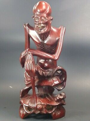 Old Chinese wise Man sitting on lotus leaf  Wood Carving  Statue. Asian wood art