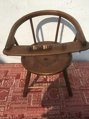 Antique wooden childs commode with enamel potty and abacus.