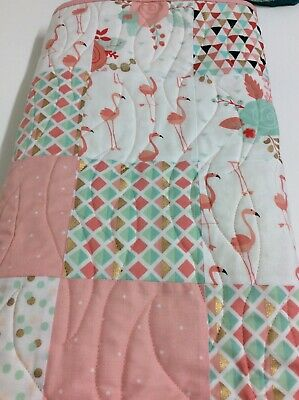 Handmade patchwork quilt for a little one. Pink Flamingos