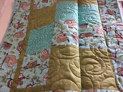 Handmade patchwork quilt for a baby or toddler. Baby sloths!