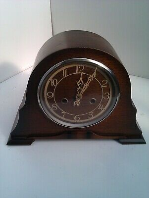 An Old Chiming Mantel Clock In Full Working Order