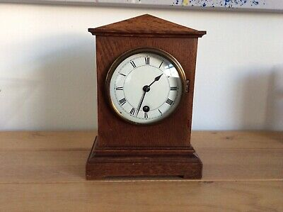 Oak cased mantel clock
