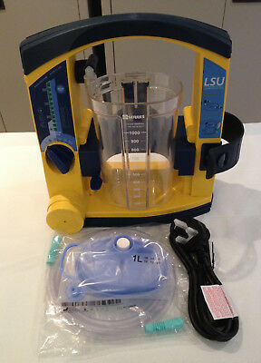 Laerdal Suction Unit LSU, Serres Canister, New Battery, Liner, Tubing & Lead