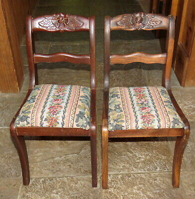 Pair of child's antique chairs - upholstered wooden rose-back