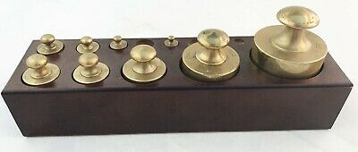 A Charming Set Of Late Victorian Weights In Brass Housed In Mahogany Container