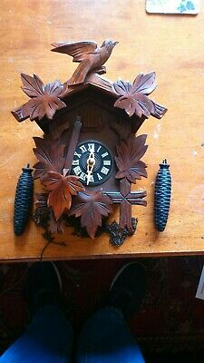cuckoo clock hubert-Her black forest spares repair untested but complete...used