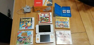 Nintendo 2DS XL Orange Boxed With Charger includes 7 3DS games perfect condition