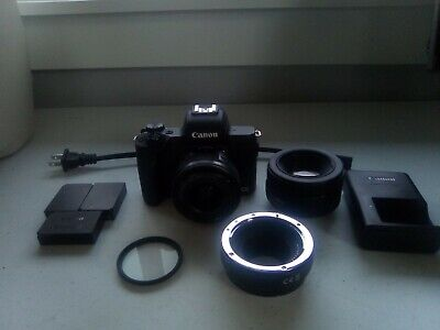 Canon EOS M50 Mirrorless Camera with 18-55 extra batteries adapter and 50mm 1.8