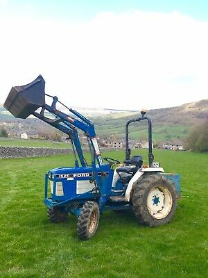 Tractor Ford 1520 compact tractor, bucket, forks,