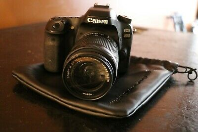 Canon EOS 80D 24.2MP DSLR Camera, 18mm-55mm kit lens, battery, charger, and bag.