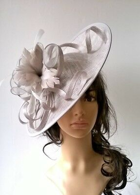 Silver Grey..sinamay & feather Hatinator shaped disc Wedding.races.new
