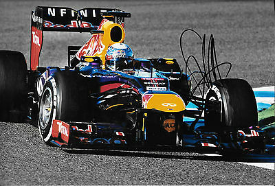 Sebastian Vettel SIGNED 12x8, F1 Red Bull RB9 . F1 Test Barcelona  2013
