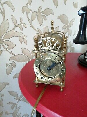 A VINTAGE SMITHS BRASS LANTERN Clock with smiths electrified movement