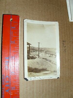 Vintage Real Photo 1900's Western Town city Dirt road street scene power line po