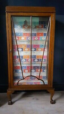 1930s vintage display cabinet with penguin classics lining