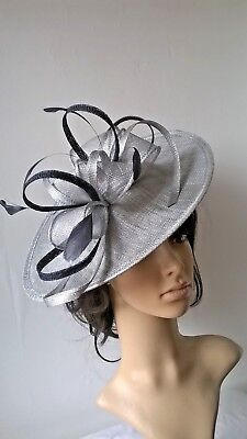 Silver grey metallic with navy Sinamay & Feather Fascinator Shaped disc,Wedding.