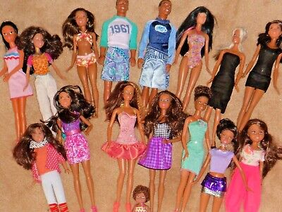 AA Barbies and Kens, in all shapes and sizes, even little ones.  16 dolls Lot 30