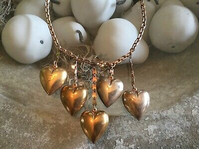 Antique vintage gold tone metal necklace with 5 large puffy hearts