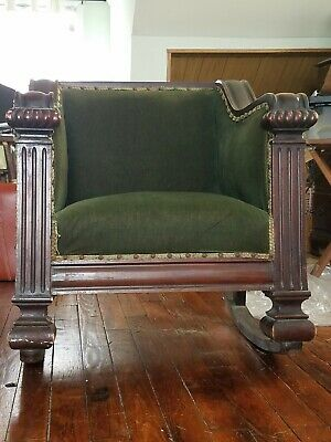 Antique wooden rocking chair with upholstery.