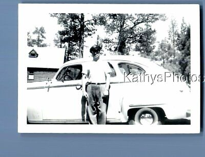 Found B&W Photo A_7258 Man In Hat Posed On Side Of Old Car
