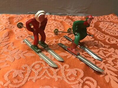 Vintage Cast Iron Ice Skiing Woman and Man with Skis Christmas Winter Figurines