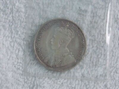Newfoundland 50 cents 1917 C and two one cent, 1943 coins