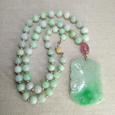 Chinese medallion, made from white-green Jade, with tourmaline and  gold links.