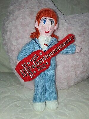 Hand knitted DAVID BOWIE doll wearing Blue suit holding a Red sequined guitar