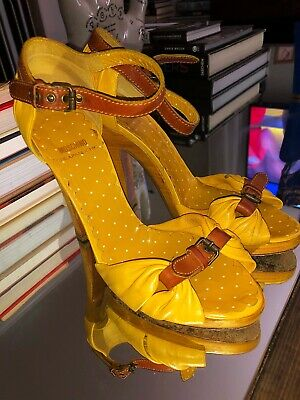 56a9508b6ca MOSCHINO CHEAP AND CHIC Yellow Mustard Leather ROSETTE Heel Wedge ...