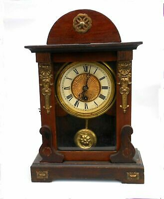 Beautiful very old antique mantle clock from a large collection.