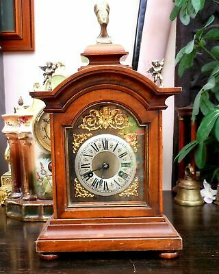 Fabulous antique mantle clock with Nefertiti finials and cherubs.