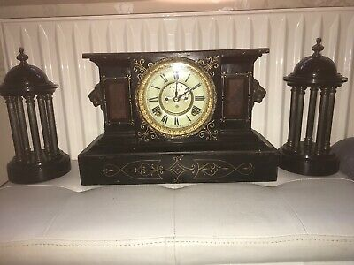 Rare Antique Ansonia mantle clock, cast iron, Victorian With Side Decorations