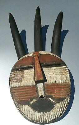 African art carving wood horned mask sculpture statue red and white from Congo.