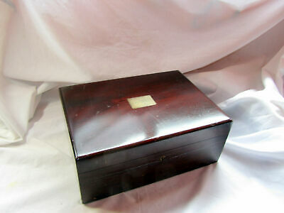 An Antique Wooden Box With Brass Inlay