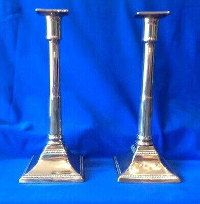 A Pair of 18 th Century English Seamed Column Candlesticks