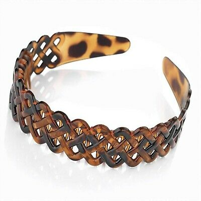 Useful brown tortoiseshell effect head band, alice band with comb inset. Attr...