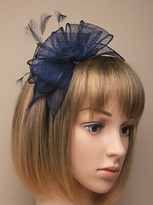 Navy blue Looped sinamay and feather fascinator on a satin fabric aliceband.