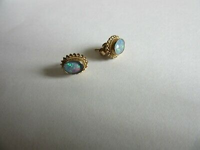 An Pair Of Beautiful Vintage 9.Ct Gold & Fiery Opal Stones Stud Earrings