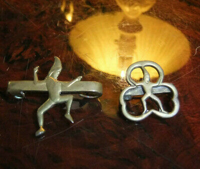 Two Old Brass Girl Guide Badges